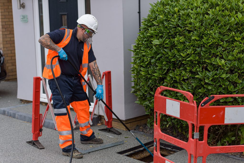 Dalrod engineer cleaning drains